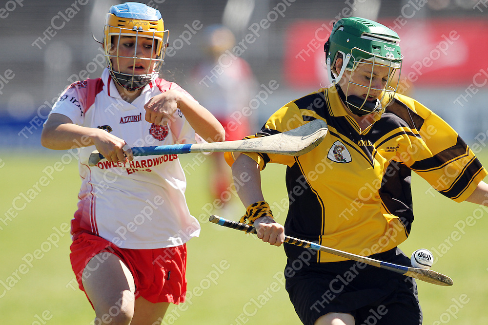 Eire Og's Clare Chadda keeps the pressure on Camross' Michelle Holmes during the Feile na nGael finals in Cusack Park on Sunday.<br /> Photograph by Yvonne Vaughan