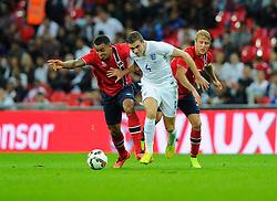 England's Jordan Henderson (Liverpool) battles for the ball with Norway's Joshua King and Norway's Per Ciljan Skjelbred  - Photo mandatory by-line: Joe Meredith/JMP - Mobile: 07966 386802 - 3/09/14 - SPORT - FOOTBALL - London - Wembley Stadium - England v Norway - International Friendly