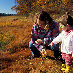 "A woman and her daughter explore the edge of a New Hampshire salt marsh. Tidal marsh.  ""Massacre Marsh."" Rye, NH"