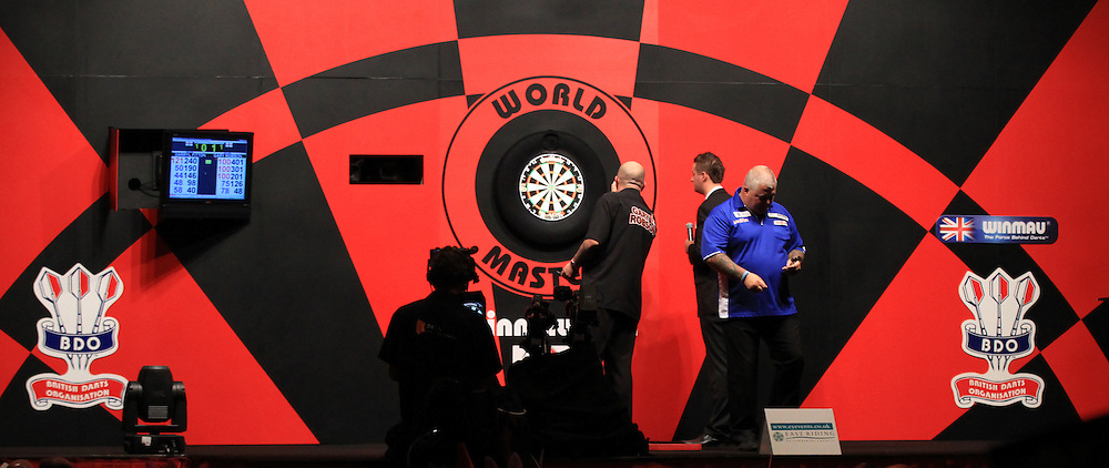 Picture by Richard Gould/Focus Images Ltd +44 7855 403186<br /> 12/10/2013<br /> Gary Robson &amp; Darryl Fitton on the stage pictured during day three of the BDO Winmau World Masters Darts Championship at Hull City Hall, Hull.
