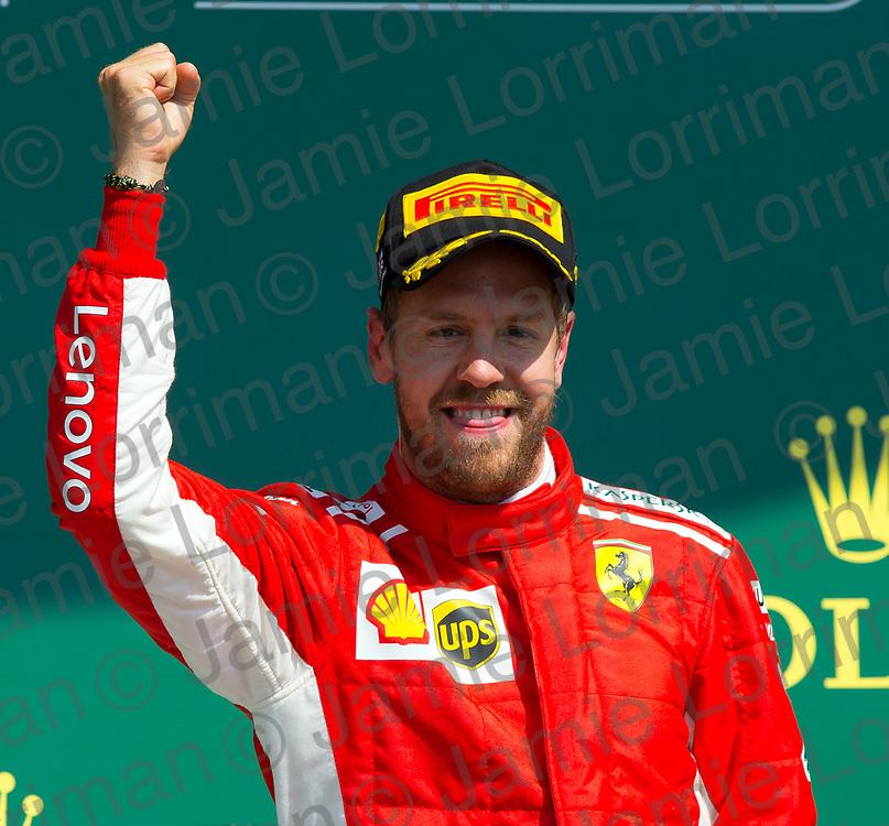 The 2018 Formula 1 F1 Rolex British grand prix, Silverstone, England. Sunday 8th July 2018.<br /> <br /> Pictured: Scuderia Ferrari driver Sebastian Vettel celebrates winning the British Formula 1 Grand Prix at Silverstone.<br /> <br /> Jamie Lorriman<br /> mail@jamielorriman.co.uk<br /> www.jamielorriman.co.uk<br /> 07718 900288