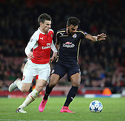 Dinamo Zagreb's El Arabi Hilal Soudani shielding the ball from Arsenal defender Laurent Koscielny during the Champions League match between Arsenal and Dinamo Zagreb at the Emirates Stadium, London, England on 24 November 2015. Photo by Matthew Redman.