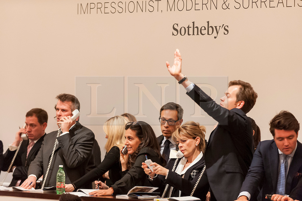 © Licensed to London News Pictures. 03/02/2015. Sotheby's, London, UK. Sotheby's London Impressionist & Modern Art Evening Sale on 3 February 2015 presented an outstanding selection of the finest and rarest works of art by the greatest artists of the 19th and 20th centuries.  Leading the sale was a group of paintings by the undoubted master of Impressionism, Claude Monet, as well as works by Henri de Toulouse-Lautrec, Henri Matisse, Edgar Degas, Auguste Rodin, Wassily Kandinsky. Pictured : agents make bids on behalf of telephone bidders.  Photo credit : Stephen Chung/LNP