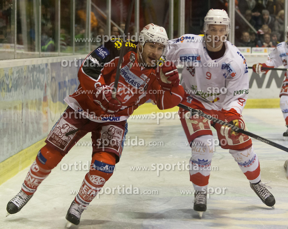 05.01.2014, Stadthalle, Klagenfurt, AUT, EBEL, KAC vs HC Bozen, 64. Runde, im Bild Tylor Spurgeon (Kac, #9), Rick Schofield (HC Bolzano, #9)// during the Erste Bank Icehockey League 64th Round match betweeen EC KAC and HC Bozen at the City Hall, Klagenfurt, Austria on 2014/01/05. EXPA Pictures © 2014, PhotoCredit: EXPA/ Gert Steinthaler