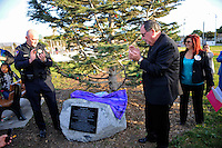 """From left, Salinas police chief Kelly McMillin, mayor-elect Joe Gunter, and founder Debbie Aguilar of the group """"A Time for Grieving and Healing"""" unveil a memorial on Sunday to the numerous victims of violence in Monterey County since 1988. The boulder, at the base of the pine """"Tree of Life"""" in Closter Park, carries a black plaque which declares it """"a living memorial to our loved ones lost to violence,"""" one whose aim is """"to bring hope, peace, love, comfort, and healing."""""""