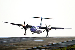 © Licensed to London News Pictures. 07/12/2017. Leeds UK. A Flybe aircraft struggles to land in strong winds at Britain's highest airport, Leeds Bradford International, wind speeds are picking up as storm Caroline approaches. Photo credit: Andrew McCaren/LNP