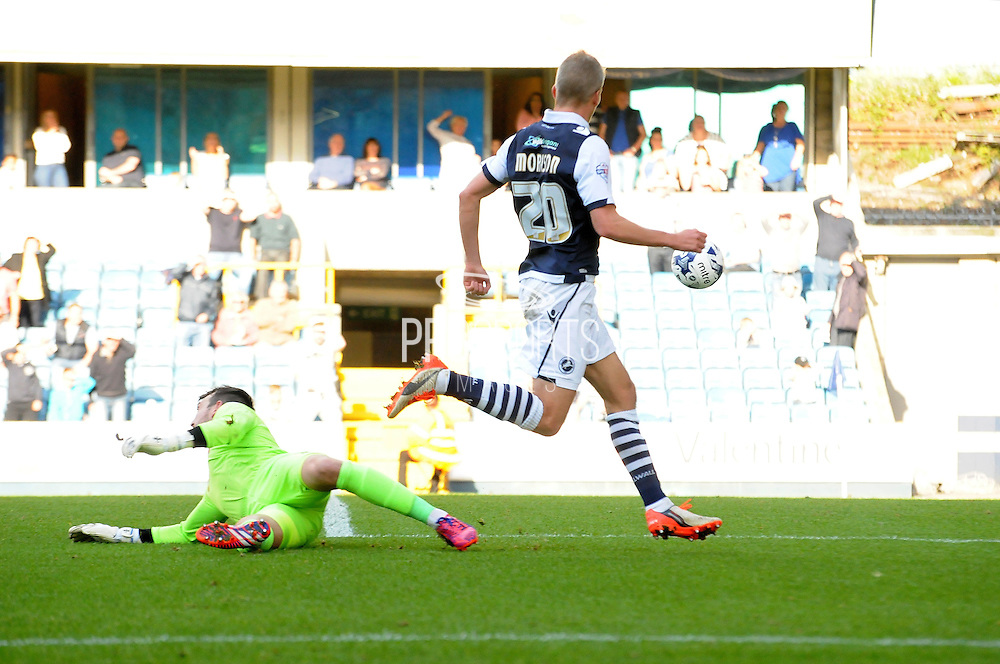 Steve Morrison chips Josh Lillis to increase Millwall's lead during the Sky Bet League 1 match between Millwall and Rochdale at The Den, London, England on 26 September 2015. Photo by Michael Hulf.