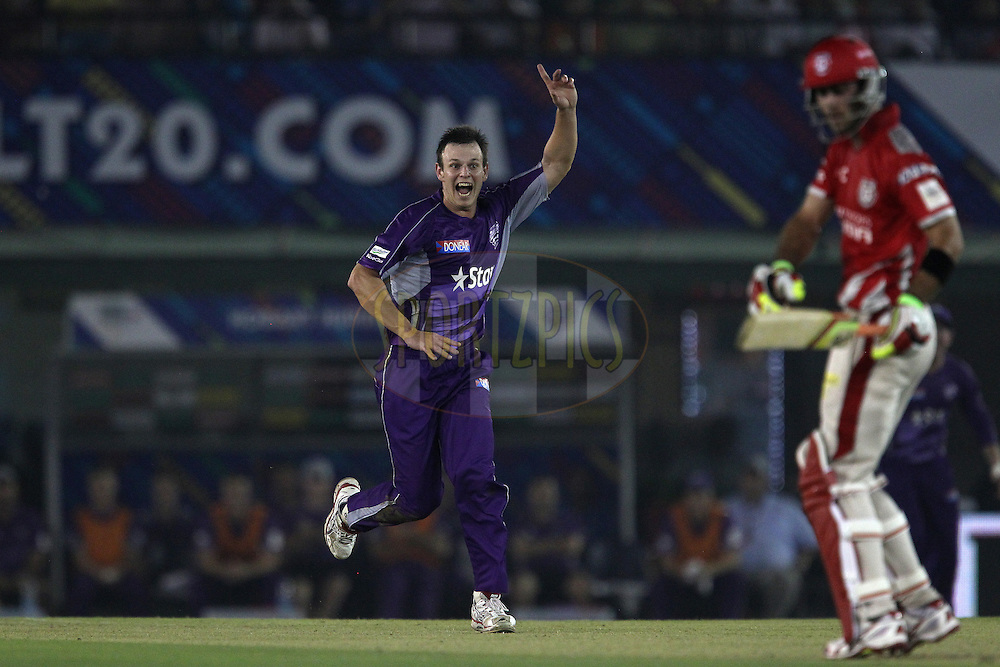 Evan GULBIS of the Hobart Hurricanes celebrates the wicket ofGlenn MAXWELL of the Kings XI Punjab  during match 2 of the Oppo Champions League Twenty20 between the Kings XI Punjab and the Hobart Hurricanes held at the Punjab Cricket Association Stadium, Mohali, India on the 18th September 2014<br /> <br /> Photo by:  Ron Gaunt / Sportzpics/ CLT20<br /> <br /> <br /> Image use is subject to the terms and conditions as laid out by the BCCI/ CLT20.  The terms and conditions can be downloaded here:<br /> <br /> http://sportzpics.photoshelter.com/gallery/CLT20-Image-Terms-and-Conditions-2014/G0000IfNJn535VPU/C0000QhhKadWcjYs