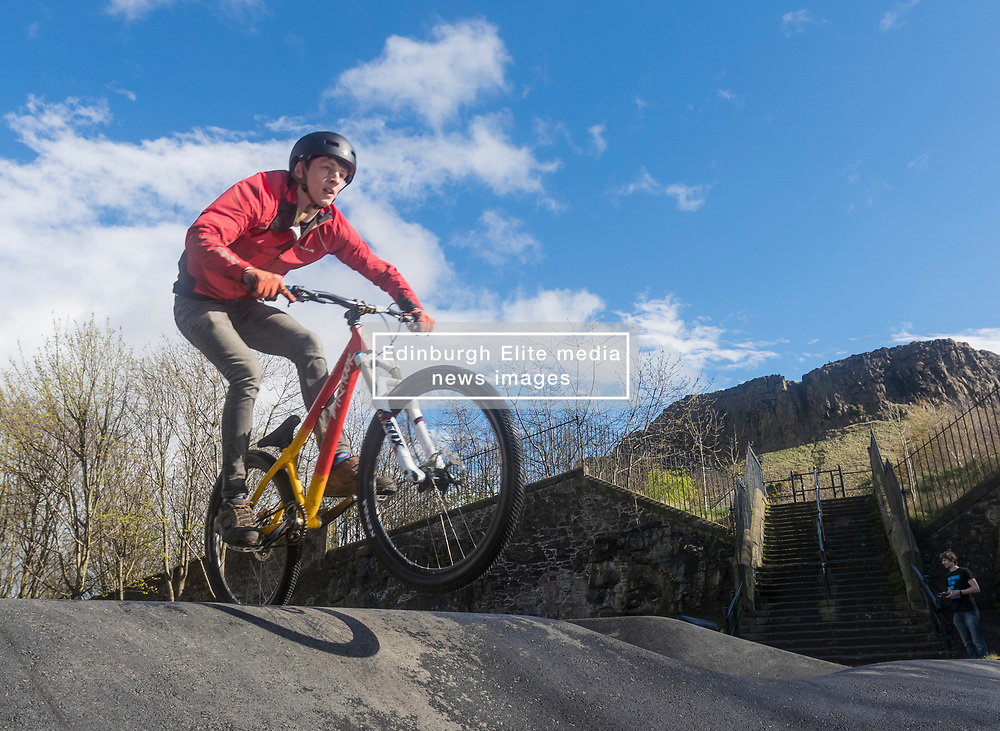 "A new bike park for mountain bikers has opened in the centre of Edinburgh. The Skelf Bike park has a 900m2 ""Pump Track"" of banked corners and mounds. The park opens today and had professional riders trying out the new track.<br /> <br /> Pictured: Angus Croudace, a local student at Edinburgh University trying out the track"