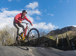A new bike park for mountain bikers has opened in the centre of Edinburgh. The Skelf Bike park has a 900m2 &quot;Pump Track&quot; of banked corners and mounds. The park opens today and had professional riders trying out the new track.<br /> <br /> Pictured: Angus Croudace, a local student at Edinburgh University trying out the track