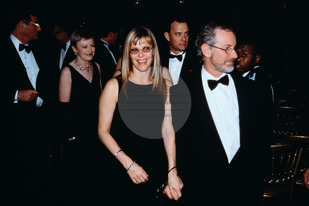 Movie director Steven Spielberg, right, with his wife Kate Capshaw during the State Dinner honoring British Prime Minister Tony Blair at the White House February 5, 1998 in Washington, DC. Actor Tom Hanks can be seen behind.