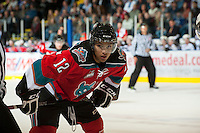KELOWNA, CANADA - OCTOBER 3:  Tyrell Goulbourne #12 of the Kelowna Rockets faces off against the Vancouver Giants at the Kelowna Rockets on October 3, 2012 at Prospera Place in Kelowna, British Columbia, Canada (Photo by Marissa Baecker/Getty Images) *** Local Caption *** Tyrell Goulbourne;