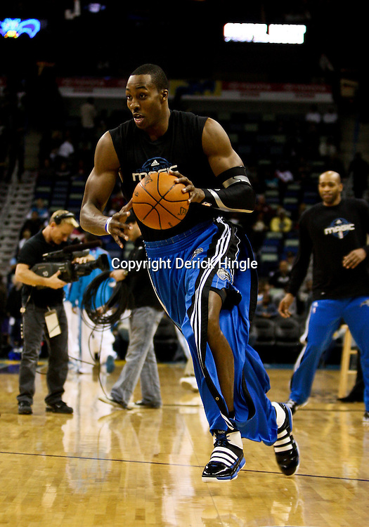 Feb 26, 2010; New Orleans, LA, USA; Orlando Magic center Dwight Howard during warm ups before tip off of a game against the New Orleans Hornets at the New Orleans Arena. The Hornets defeated the Magic 100-93. Mandatory Credit: Derick E. Hingle-US PRESSWIRE