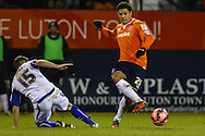 Nathan Doyle of Luton Town (right) beats Ryan Lowe of Bury (left) during the The FA Cup match at Kenilworth Road, Luton<br /> Picture by David Horn/Focus Images Ltd +44 7545 970036<br /> 16/12/2014