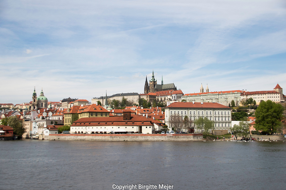 View from across river Moldau in Prague toward Prague Castle and the Sct. Vitus Cathedral on the Castle grounds.