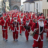 NOALE, ITALY - DECEMBER 18:  Participants dressed as Father Christmas take part in the Noale Santa Run on December 18, 2011 in Noale, Italy. Close to two thousand people participated in the third annual Noale Santa Run, one of the largest non competitive Santa Run in Italy.
