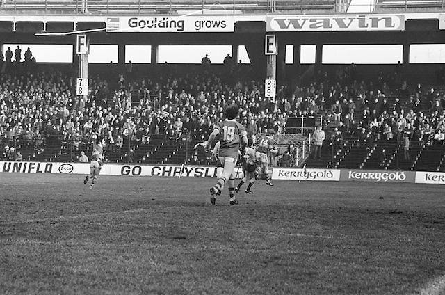 Players in the distance jump for possession of the ball during the All Ireland Senior Gaelic Football Semi Final, Dublin v Kerry in Croke Park on the 23rd of January 1977. Dublin 3-12 Kerry 1-13.