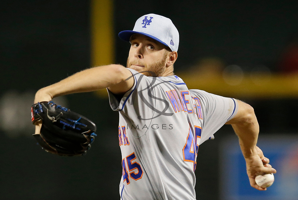 New York Mets pitcher Zack Wheeler throws in the first inning during a baseball game against the Arizona Diamondbacks, Sunday, June 17, 2018, in Phoenix. (AP Photo/Rick Scuteri)