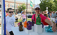 Emma Gostonczik (from left), 11, and her mother, Sarah Gostonczik, both of Marion, look at glass items for sale at a booth during the 20th Annual Marion Arts Festival at City Square Park in Marion on Saturday, May 19, 2012. (Stephen Mally/Freelance)