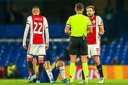 YELLOW CARD Ajax defender Daley Blind (17) booked by referee Gianluca Rocchi for a foul on Chelsea midfielder Mateo Kovacic (17) during the Champions League match between Chelsea and Ajax at Stamford Bridge, London, England on 5 November 2019.