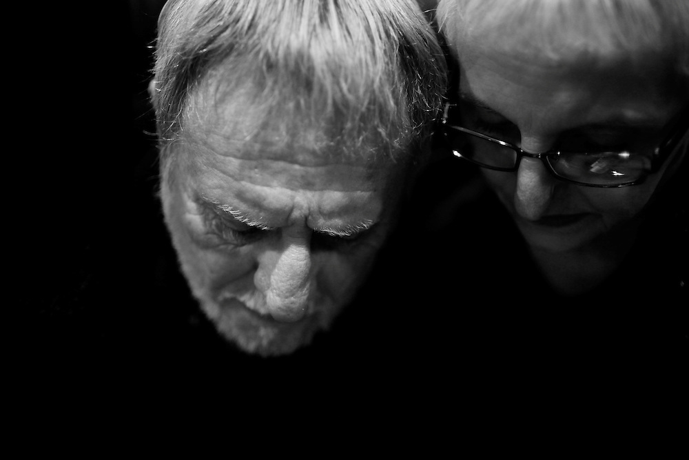 Bob and Alicia Mobley huddle close together at their home in Naples, Fla. It had been almost two years since they lost their son, Chris, who died of a drug overdose. They still aren't sure if he was just trying to get high, or if he committed suicide.