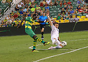 Swope Park forward Killian Colombie(53) slide tackles into Tampa Bay Rowdies midfielder Kwadwo Poku(88) for the ball during a USL soccer game, Sunday, May 26, 2019, in St. Petersburg, Fla. The Rowdies defeated the Rangers 1-0. (Brian Villanueva/Image of Sport)