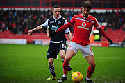 Tom Bradshaw of Walsall FC and Shane Ferguson of Millwall FC during the Sky Bet League 1 match between Walsall and Millwall at the Banks's Stadium, Walsall, England on 6 February 2016. Photo by Mike Sheridan.
