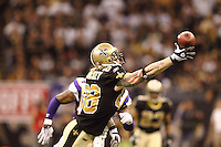 NEW ORLEANS - JANUARY 24: Jeremy Shockey #88 of the New Orleans Saints reaches for a pass against the Minnesota Vikings at the NFC Championship Game at the Louisiana Superdome on January 24, 2010 in New Orleans, Louisiana. The Saints won 31-28 in overtime to advance to the Super Bowl for the first time. Photo by Tom Hauck.
