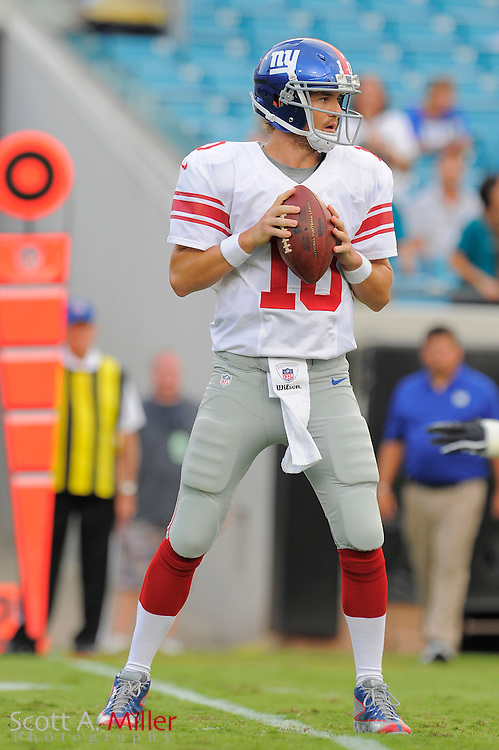 New York Giants quarterback Eli Manning (10) looks to throw during the Giants NFL preseason game against the Jacksonville Jaguars at EverBank Field on August 10, 2012 in Jacksonville, Florida. ©2012 Scott A. Miller..