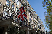 The union Jack flies from a property in Beaufort Gardens, on 9th April 2017 in Knightsbridge, London SW3, England.