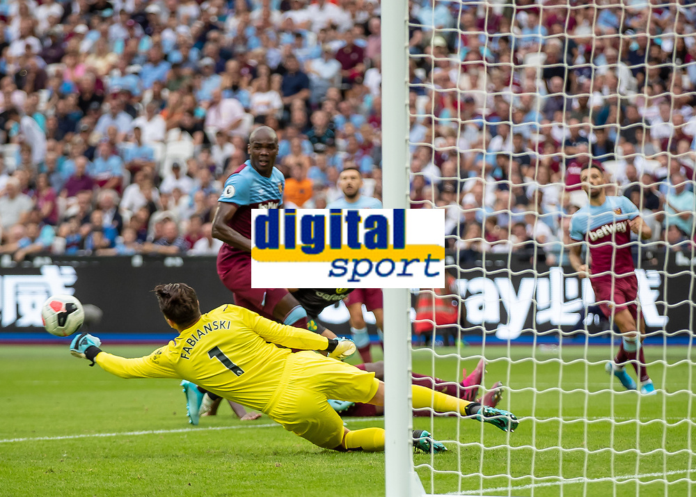 Football - 2019 / 2020 Premier League - West Ham United vs. Norwich <br /> <br /> Lukasz Fabianski (West Ham United) puches away the low driven cross across his penalty box at the London Stadium<br /> <br /> COLORSPORT/DANIEL BEARHAM