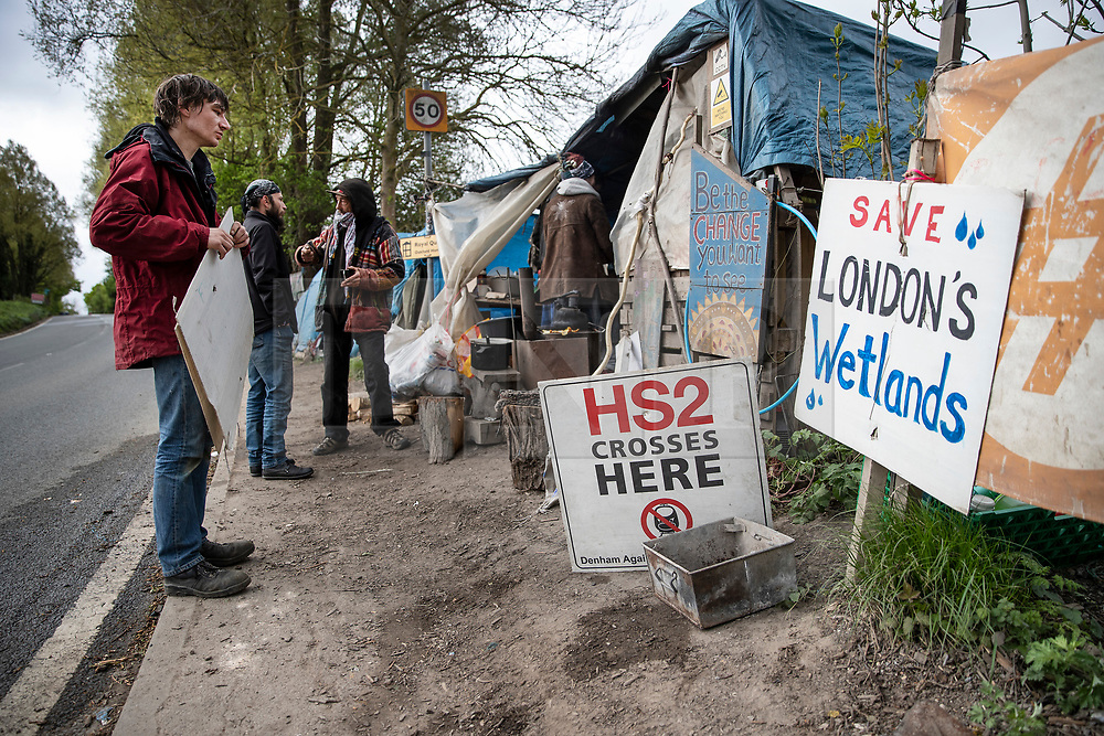 © Licensed to London News Pictures. 28/04/2019. London, UK. Extinction Rebellion activists have joined with Stop HS2 protestors at a roadside camp and to occupy trees in Colne Valley to stop their felling for the HS2 rail project. Workers were expected to start cutting down the trees yesterday and to continue today but the protests have stopped the work. Photo credit: Peter Macdiarmid/LNP