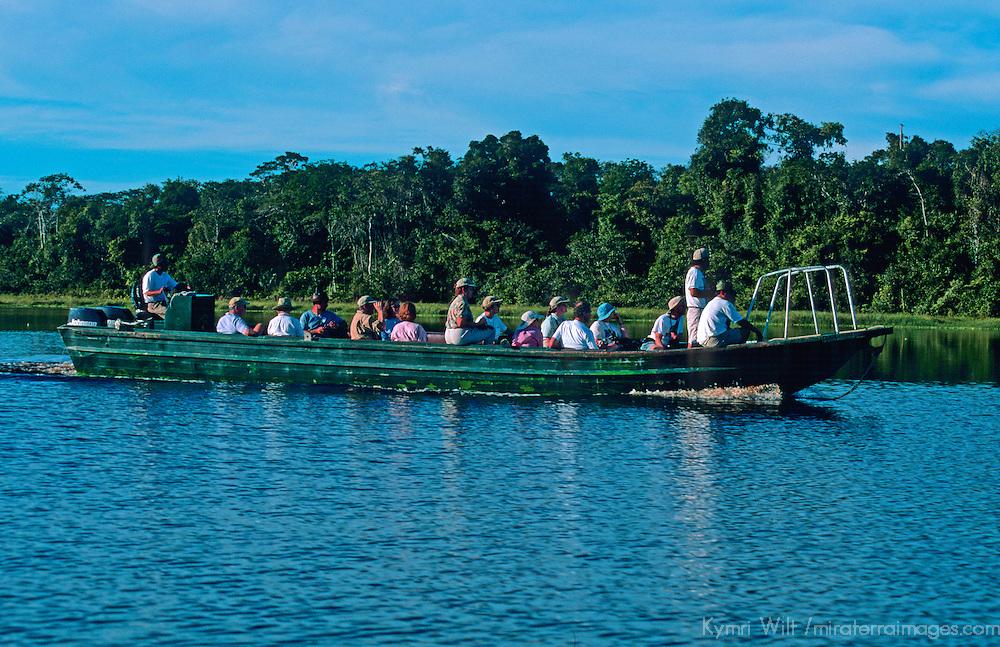 South America, Peru, Amazon River. Tour group on Amazon excursion