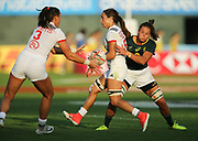 DUBAI, UNITED ARAB EMIRATES - Thursdays 30 November 2017, Ryan Carlyle of the USA offloads just as Marithy Pienaar of South Africa tries to tackle her during HSBC Emirates Airline Dubai Rugby Sevens match between South Africa and the USA at The Sevens Stadium in Dubai.<br /> Photo by Roger Sedres/ImageSA