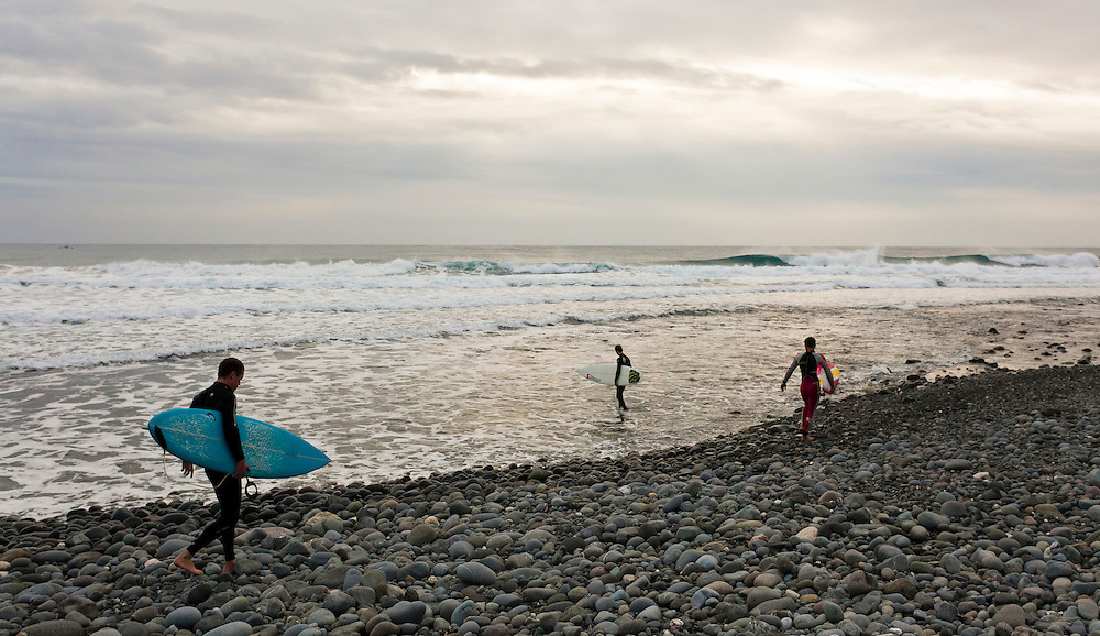 Surfers head out for some early morning waves at Donghe on the east coast of Taiwan.