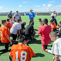 080404       Adron Gardner<br /> <br /> Gallup High School varsity football coach Chris McKeown talks to his players during football practice at Gallup High School in Gallup Monday.