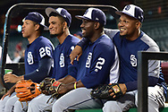Sep 8, 2017; Phoenix, AZ, USA; San Diego Padres infielder Yangervis Solarte (26), outfielder Allen Cordoba (17), outfielder Jose Pirela (2) and infielder Erick Aybar (8) smile during batting practice prior to the MLB game against the Arizona Diamondbacks at Chase Field. Mandatory Credit: Jennifer Stewart-USA TODAY Sports
