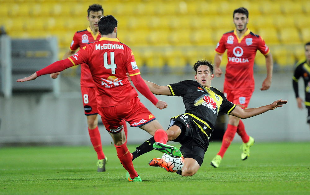 Phoenix's Alex Rodriguez, right, tackled by Adelaide United's Dylan McGowan in the A-League football match at Westpac Stadium, Wellington, New Zealand, Friday, November 13, 2015. Credit:SNPA / Ross Setford