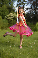 Old Westbury, New York, U.S. - June 21, 2014 - REGAN, 7, of New Jersey, is one of many young girl visitors dressed in fairy costumes to see the Lori Belilove & The Isadora Duncan Dance Company dance throughout the gardens during the Midsummer Night event at the Long Island Gold Coast estate of Old Westbury Gardens on the first day of summer, the summer solstice.