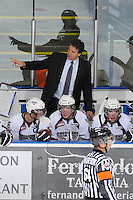 KELOWNA, CANADA, OCTOBER 5: Jim Hiller, head coach of the Tri City Americans discusses a play on the bench against the Kelowna Rockets on October 5, 2011 at Prospera Place in Kelowna, British Columbia, Canada (Photo by Marissa Baecker/shootthebreeze.ca) *** Local Caption ***Jim Hiller;