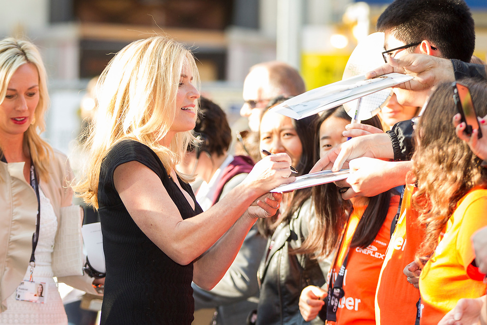 Elisabeth Shue sings autographs for fans as she arrives for the premiere of 'Battle of the Sexes' at the Toronto International Film Festival in Toronto, Ontario, September 10, 2017.