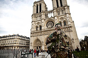 Paris | 03 December 2015<br /> <br /> On the evening of 13 November 2015, a series of coordinated terrorist attacks occurred in Paris, the capital of France, and its northern suburb, Saint-Denis. Beginning at 21:20 CET, three suicide bombers struck near the Stade de France in Saint-Denis, followed by suicide bombings and mass shootings at caf&eacute;s, restaurants and the music venue Bataclan in Paris.<br /> The attackers killed 130 people (state of Dec 09, 2015), including 89 at the Bataclan, where they took hostages before engaging in a stand-off with police forces. There were 368 injuries. Seven of the attackers also died.<br /> The attacks were the deadliest on France since World War II and the deadliest in the European Union since the Madrid train bombings in 2004.<br /> Here: A soldier with a submachine gun is seen standing guard in front of Notre Dame cathedral.<br /> <br /> &copy;peter-juelich.com<br /> <br /> [No Model Release | No Property Release]