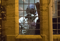 © Licensed to London News Pictures. 06/03/2018. Salisbury, UK. A police forensics officer in a protective suit and gas mask appears to be holding an evidence bag as he works inside The Mill pub in Salisbury, Wiltshire, where former Russian spy Sergei Skripal and his daughter visited before becoming ill with suspected poisoning. The couple where found unconscious on bench in Salisbury shopping centre. Specialist units have been called in to deal with any possible contamination. Photo credit: Peter Macdiarmid/LNP