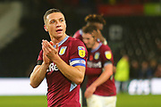 Aston Villa defender James Chester (5) applauds the Aston Villa fans after the final whistle during the EFL Sky Bet Championship match between Derby County and Aston Villa at the Pride Park, Derby, England on 10 November 2018.