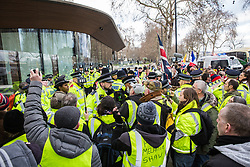 London, UK. 2nd February, 2019. Tensions rise following an arrest by the Metropolitan Police among supporters of Yellow Vests UK protesting outside New Scotland Yard to call for 'British people to be put first', for a 'full Brexit' and for 'an end to government, court and banking corruption'.