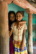 Girls stands beside a wooden pillar at her home in Tranquebar. Tranquebar was once a Danish Colony.