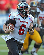 August 31 2013: Northern Illinois Huskies quarterback Jordan Lynch (6) scrambles with the ball during the second half of the NCAA football game between the Northern Illinois Huskies and the Iowa Hawkeyes at Kinnick Stadium in Iowa City, Iowa on August 31, 2013. Northern Illinois defeated Iowa 30-27.