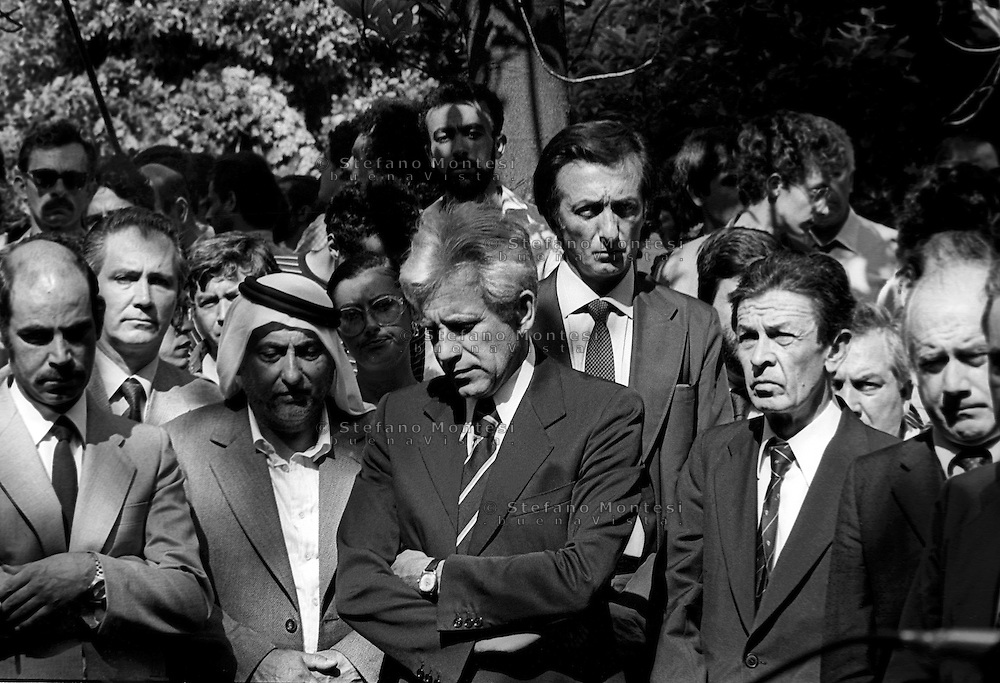 ROME, ITALY - JULY 17: Enrico Berlinguer (R) National Secretary of the Italian Communist Party, Lucio Magri (C) secretary of the Proletarian Unity Party for Communism behind Ugo Pecchioli Italian Communist Party the day of the funerals of Hussein Kamal and Nazyh Mattar, Palestinian leaders Palestine Liberation Organization (PLO), killed in Rome two car bombs.  on July 17,1982 in Rome, Italy.