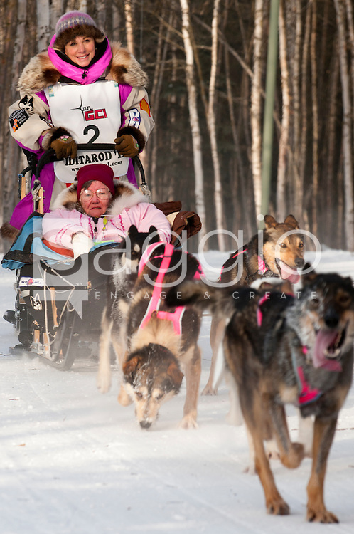 Musher DeeDee Jonrowe and Iditarider Beverley Nelms stroll along the Chester Creek Trail during the 2011 Ceremonial Start.