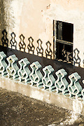 Architectural detail of mosque casting shadow on next building, Lamu, Kenya, Africa.